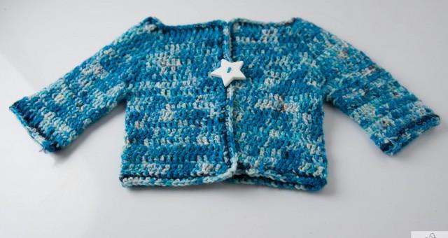 A baby waistcoat in crochet